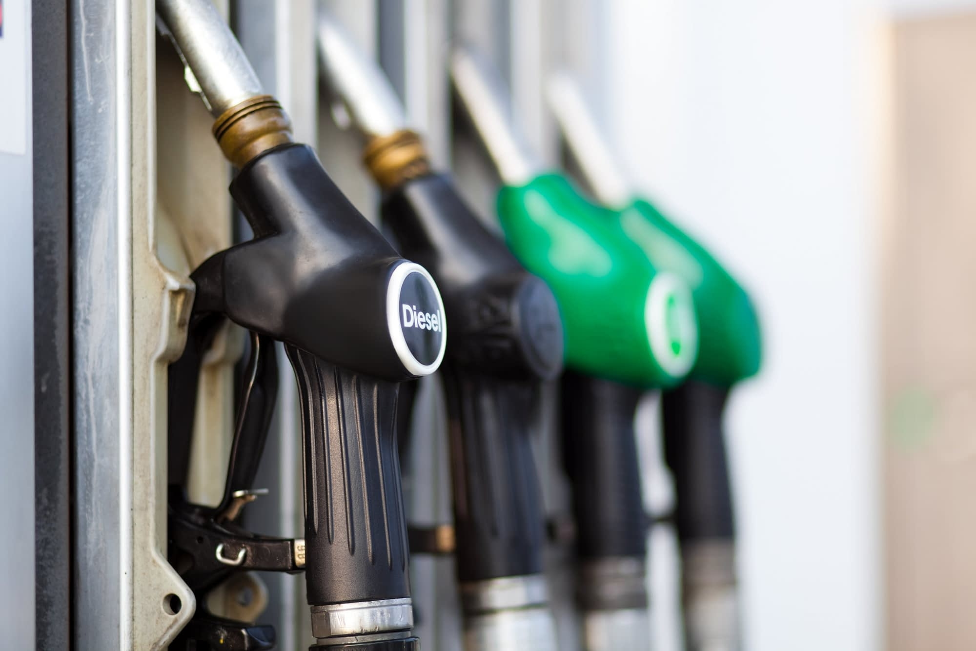 Diesel and petrol nozzles at fuel station